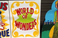 world of wonders wood sign