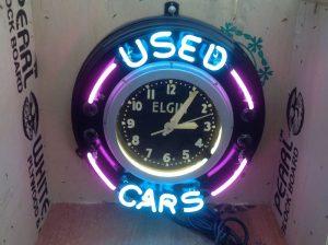 neon used cars clocks 2